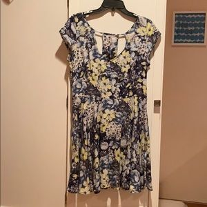A blue dress with a different color flower design.